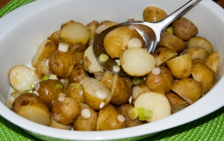 Warm Jersey Royals in a vinagrette dressing