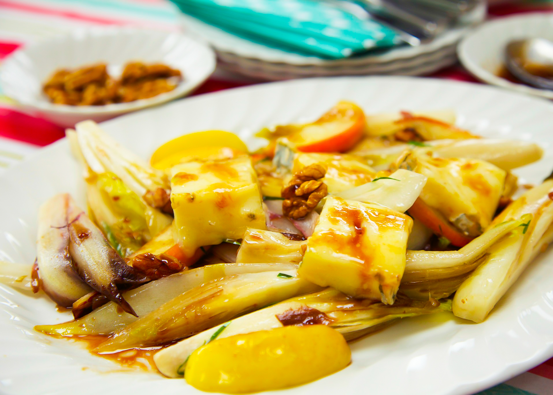 Warm apple, chicory, and taleggio salad